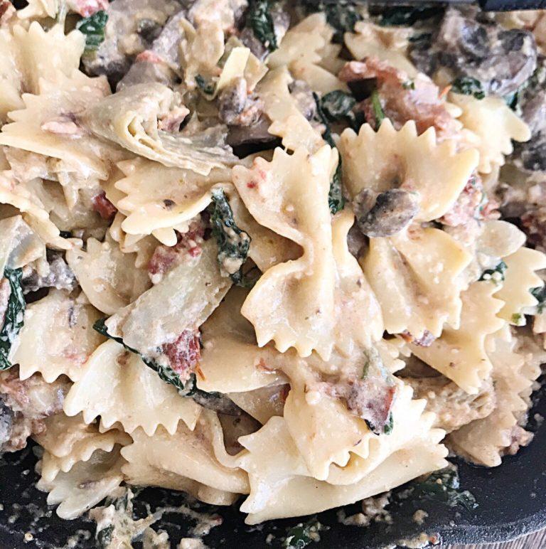 Bacon, Artichoke, Mushroom Loaded Bowtie Pasta with a Creamy Alfredo