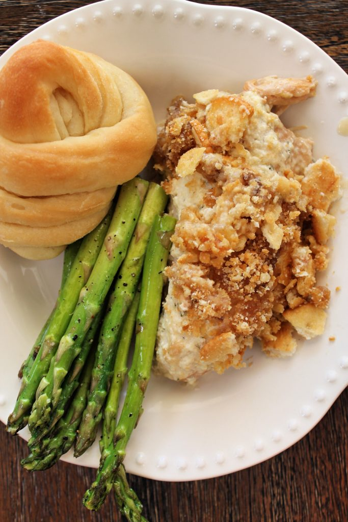 Crockpot Ritz Chicken with a roll and asparugus